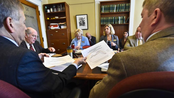 Bill Talbott, deputy commissioner at the Agency of Education, second from left, briefs the House Education Committee at the Statehouse in Montpelier in 2015.