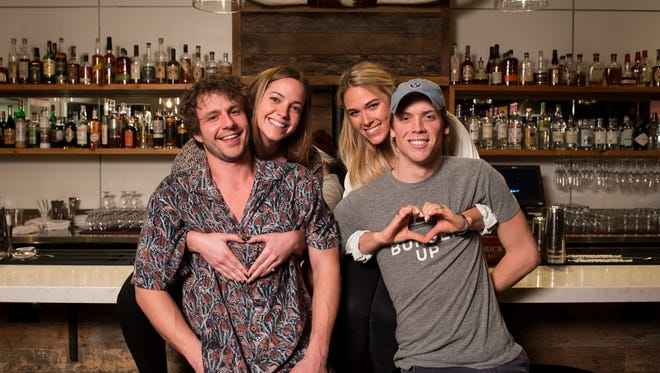 From left, Kirk Sudduth, Mary Stanton Sudduth, Layton Byrd and Cody Byrd pose for a portrait at Burger Up in Nashville on Friday, Feb. 10, 2017. The two couples met and fell in love while working at Burger Up and still work alongside each other years later.