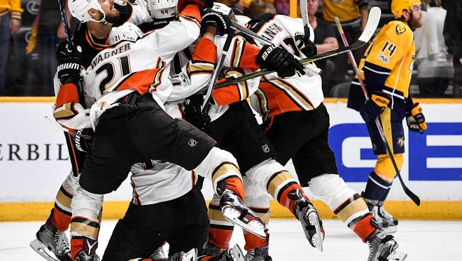 The Anaheim Ducks celebrate Nate Thompson's game winning goal against the Nashville Predators in overtime of game 4 of the Western Conference finals at Bridgestone Arena in Nashville, Tenn., Thursday, May 18, 2017.