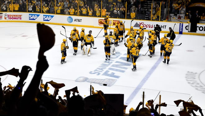 Fans cheer as the Predators exit the ice after their loss to the Penguins in Game 6 of the Stanley Cup Final at Bridgestone Arena on Sunday, June 11, 2017.