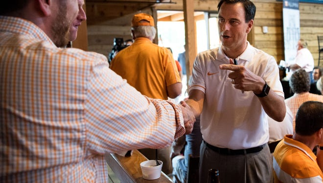 John Currie, then University of Tennessee director of athletics, greets fans during a Big Orange Caravan event in Arrington, Tenn., July 10, 2017.