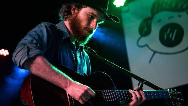 """Colter Wall performs during the """"The Songs of John Prine"""" tribute concert at The Basement East in Nashville, Tenn., Thursday, July 27, 2017."""