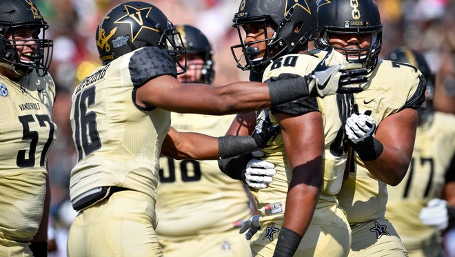Vanderbilt tight end Jared Pinkney (80) celebrates his touchdown against Alabama A&M wtith wide receiver Kalija Lipscomb (16) during the first half of an NCAA football game at Vanderbilt Stadium in Nashville, Tenn., Saturday, Sept. 9, 2017.