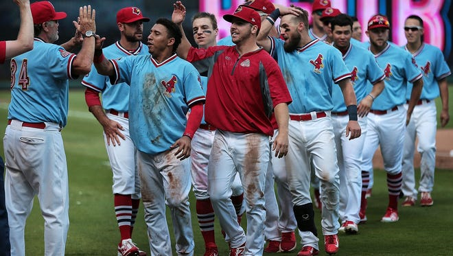 The Redbirds, shown here celebrating a win last week in the PCL championship series, couldn't overcome a fourth-inning grand slam by the Durham Bulls in the Triple-A national championship game on Tuesday night.