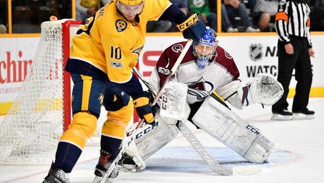 Colorado Avalanche goalie Semyon Varlamov (1) defends against Nashville Predators center Colton Sissons (10) during the third period at Bridgestone Arena in Nashville, Tenn., Tuesday, Oct. 17, 2017.