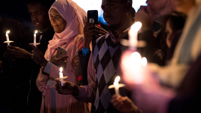 """Attendees hold candles during a """"We All Belong"""" rally at Coleman Park in Nashville, Tenn., Wednesday, Oct. 18, 2017."""