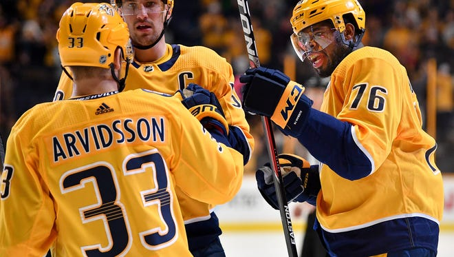 Nashville Predators defenseman P.K. Subban (76) celebrates his goal against the Buffalo Sabres during the first period at Bridgestone Arena in Nashville, Tenn., Saturday, March 31, 2018.