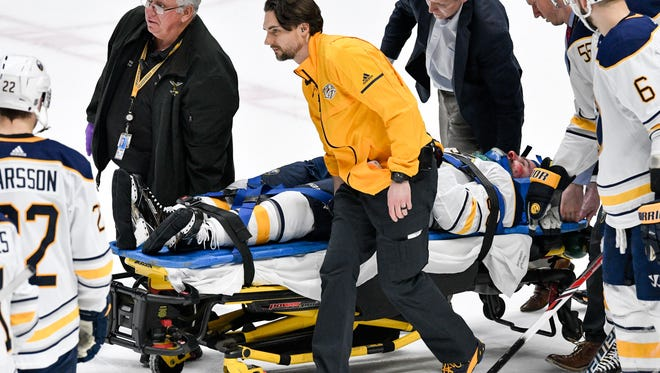 Sabres defenseman Victor Antipin is carried off the ice after an injury during the second period Saturday.