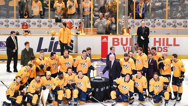 The Nashville Predators pose with the Presidents' Trophy before a game against the Columbus Blue Jackets at Bridgestone Arena, Saturday, April 7, 2018, in Nashville, Tenn.