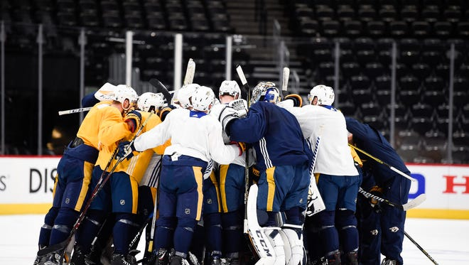 The Predators huddle up during practice Tuesday at the Pepsi Center in Denver.