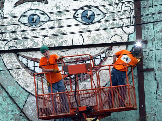 "2004   L-R Hank Emery, New Egypt and Andrew Warshawer, Hightstown, both from Universal Fabricators in Jackson, weld a metal frame around Palace Amusements ""Tillie"" before lifting it out to be preserved. Asbury Park Press File Photo"