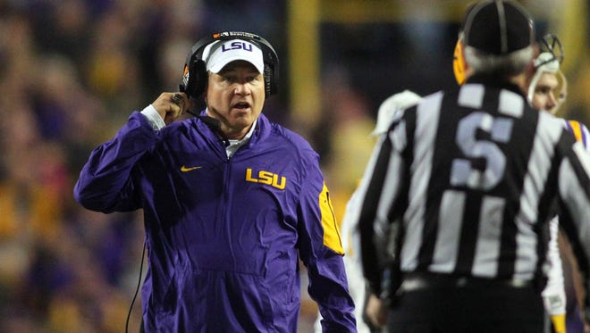 LSU coach Les Miles was fired four games into his 12th season with the school.
