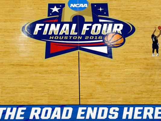 Villanova's Kris Jenkins (2) shoots a game winning three point basket in the closing seconds of the NCAA Final Four tournament college basketball championship game against North Carolina, Monday, April 4, 2016, in Houston. Villanova won 77-74. (AP Photo/David J. Phillip)