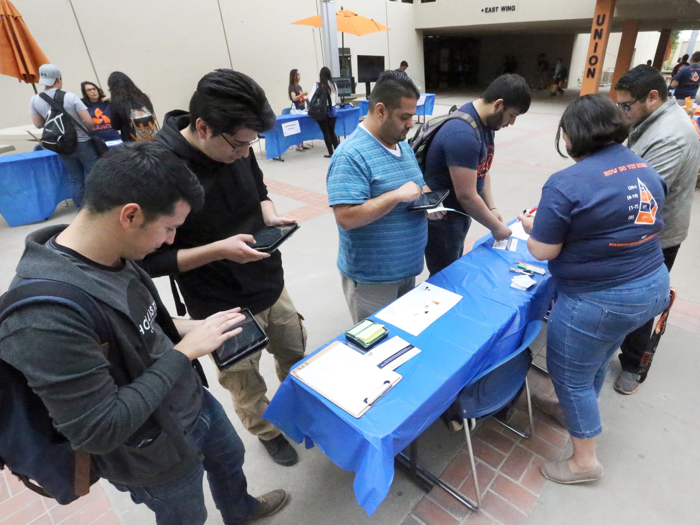 UTEP students fill out a questionnaire at a research initiative Thursday, April 7 in the courtyard of the Student Union building on campus. The research was being conducted by the Latinos Alcohol Health Disparities Research Center at UTEP.