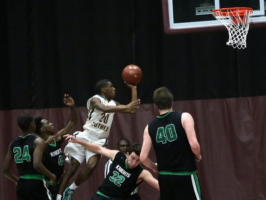 Martin Luther's Trequan Carrington goes up for a basket