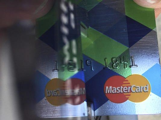 NerdWallet-In Debt Over Your Head