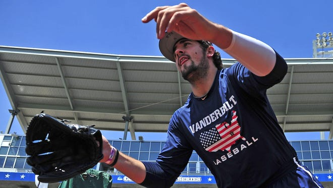 Vanderbilt reliever Ben Bowden, taking the field for practice Sunday, has yet to take the mound in the College World Series.