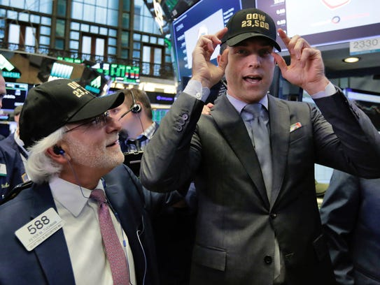 Trader Peter Tuchman, left, and New York Stock Exchange