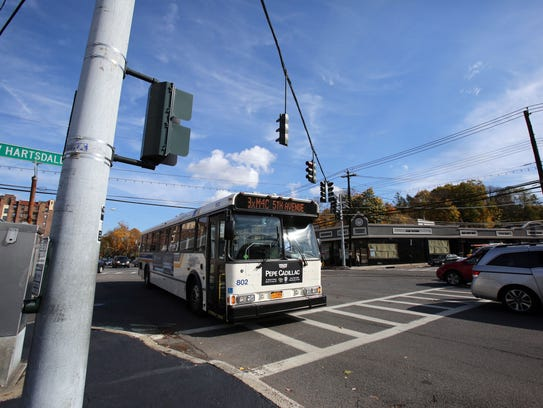 Vehicles drive south on Central Park Avenue at the