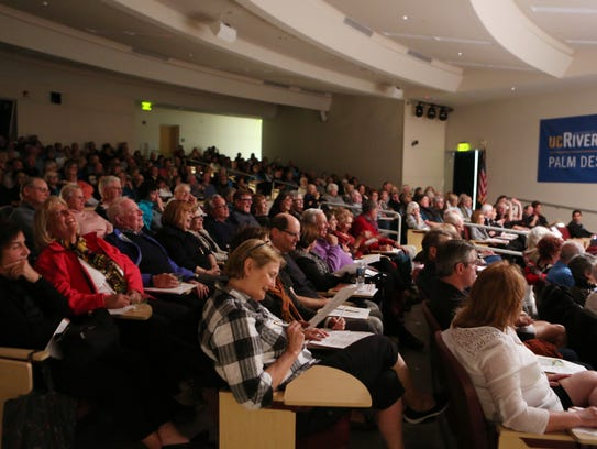 A crowd fills the auditorium at UCR Palm Desert for