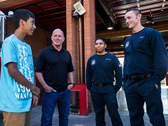 Eric Mendez, 14, talks with Ryan Mingis, Hector Lopez,