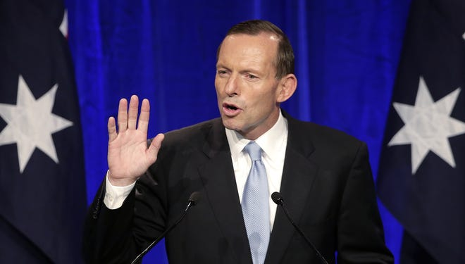Opposition leader Tony Abbott makes a speech to party supporter in Sydney, on Sept. 7, 2013, following his win in Australia's national election.