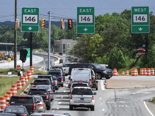 Cars drive exit off of state highway 385 to get on Woodruff Road in Greenville on Wednesday. Construction projects on both roads, and nearby I-85 have created traffic slow downs.