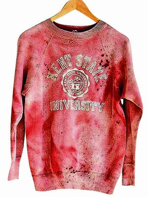 Hip apparel retailer Urban Outfitters was at the center of a firestorm this week when it began selling a Kent State University sweatshirt spattered with what looked like blood.