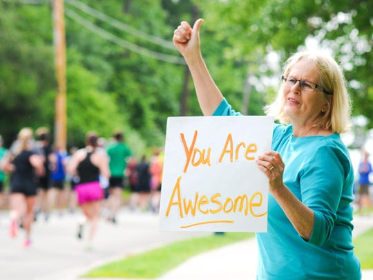 Cheering on Bellin Run participants is an annual tradition for retired West De Pere Elementary School teacher Mary Jo Scanlan.