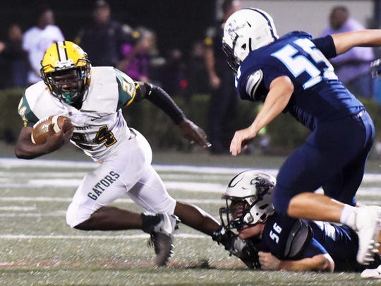 Captain Shreve's Demarcus McCall tries to get past Loyola Prep's defense Friday evening at Loyola's Messmer Stadium.