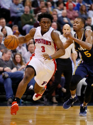 Pistons forward Stanley Johnson drives to the basket past Jazz guard Rodney Hood in the second quarter of the Pistons' 95-92 win over the Jazz on Jan. 25, 2016 at Salt Lake City.