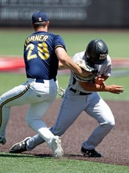 Kent State's Michael Turner tags out New Mexico State's