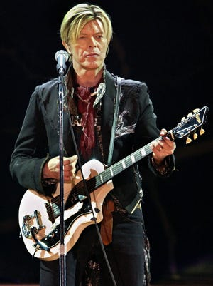 David Bowie, here in concert in 2003, died of cancer at 69.