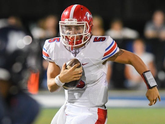 Jackson Prep quarterback Chance Lovertich runs the ball against Jackson Academy during game action Friday, September 29, 2017 at Raider Field in Jackson, MS.(Bob Smith-For the Clarion Ledger)