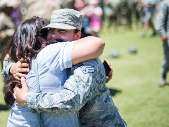 Senior Airman Lesley Trevizo embraces her aunt, Debra Salas, as she congratulates her on earning the Air Assault Badge. Trevizo is the first woman in the Air Force to graduate from the Fort Bliss Army Air Assault School, Iron Training Detachment.