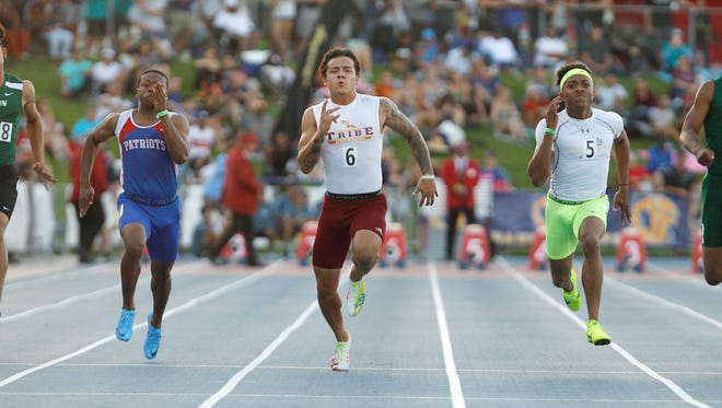 Kazmeir Allen of Tulare Union leads the pack as he heads to the line winning the 100 meter dash at the CIF Track and Field Championships at Buchanan High School Saturday, June 2, 2018 in Clovis, Calif.
