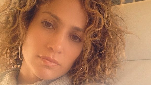 Jennifer Lopez shows off her real hair.