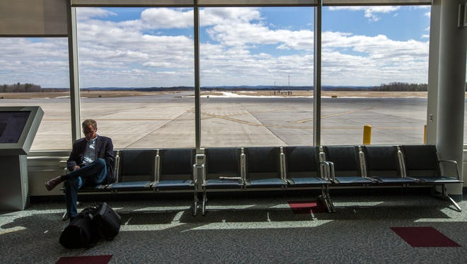A man waits to board his flight in the terminal at the Greater Binghamton Airport on March 29, 2017.