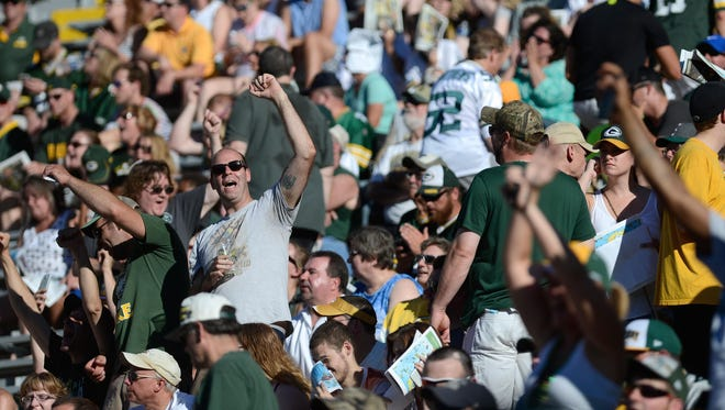 Fans cheer as they wait for Brett Favre to come out and speak in the bowl of Lambeau Field to a sold out crowd as he is inducted into the Green Bay Packers Hall of Fame.