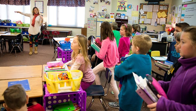 Third grade teacher Shelley Watts instructs her students where to sit down during a two-hour delay schedule in this 2017 photo taken at Fletcher Elementary School. State law will require smaller classes in kindergarten through third grade next school year, but changes are being discussed.