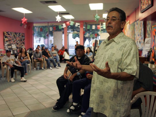 "Buddy Salinas, a former baseball player in Ventura County, speaks about his baseball experiences to guests Sept. 23 during a book signing of ""Mexican-American Baseball in Ventura County"" at the Cafe On A, in Oxnard."