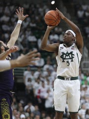 Michigan State Spartans guard Cassius Winston scores against Notre Dame guard Matt Farrell in the first half Thursday, Nov. 30, 2017 at the Breslin Center in East Lansing.