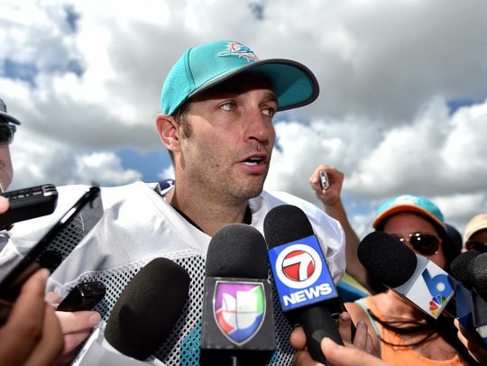 Miami Dolphins quarterback Jay Cutler (6) fields questions