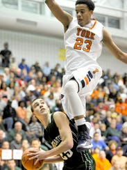 William Penn's Jahaire Wilson (23) defends Methacton's Justin Ardman in the second half of a PIAA Class AAAA first-round game Saturday. The Bearcats won, 67-63. (Daily Record/Sunday News -- Chris Dunn)