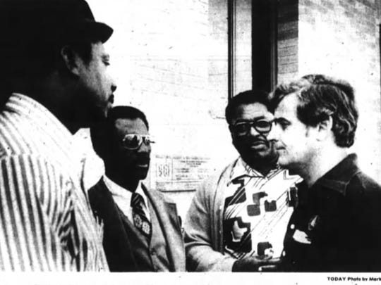 A 1979 photo from Florida Today shows Victor Hart Sr., Donald Brown and Robert Temple, of the Progressive Civic League, talking with Bunny Siebert after a meeting about securing low-income housing for Gifford.