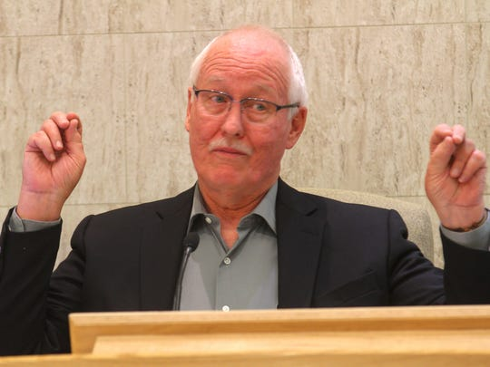 Former district judge William Birdsall leads a name change clinic Tuesday for residents seeking a Real ID-compliant driver's license at the Farmington District Court.