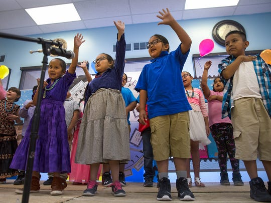 Dream Diné Charter School students perform a song Friday during a year-end program at the Shiprock Chapter House.