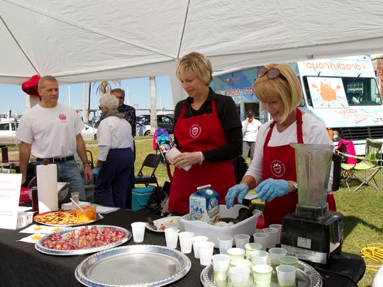 Jeanne Struve, left, and Kathy Reynaert-Randall prepare smoothie samples for attendees at the 2nd annual Streets Alive! in downtown Fort Myers.
