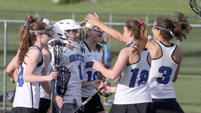 Bronxville celebrates after defeating Putnam Valley 19-4 to capture the Section 1 Class D girls lacrosse championship at Yorktown High School May 24, 2017.