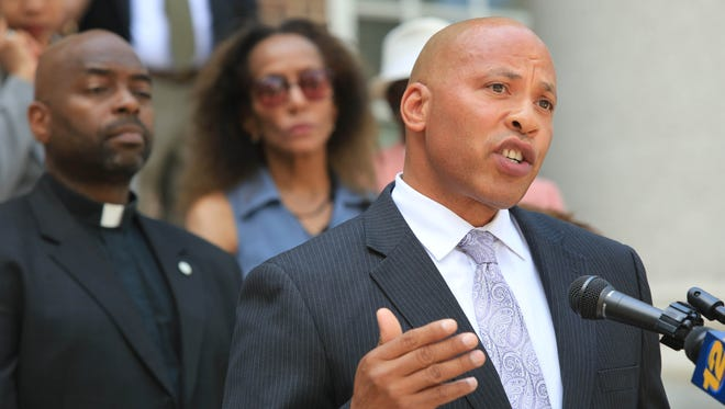 Mount Vernon Commissioner of Police Terrance Raynor speaks during a press conference on the arrest of Lloyd Lewis, 32, who was charged with 1st degree murder in the death of 86 year old neighbor, Emma Gruber outside CIty Hall in Mount Vernon on July 30, 2014.